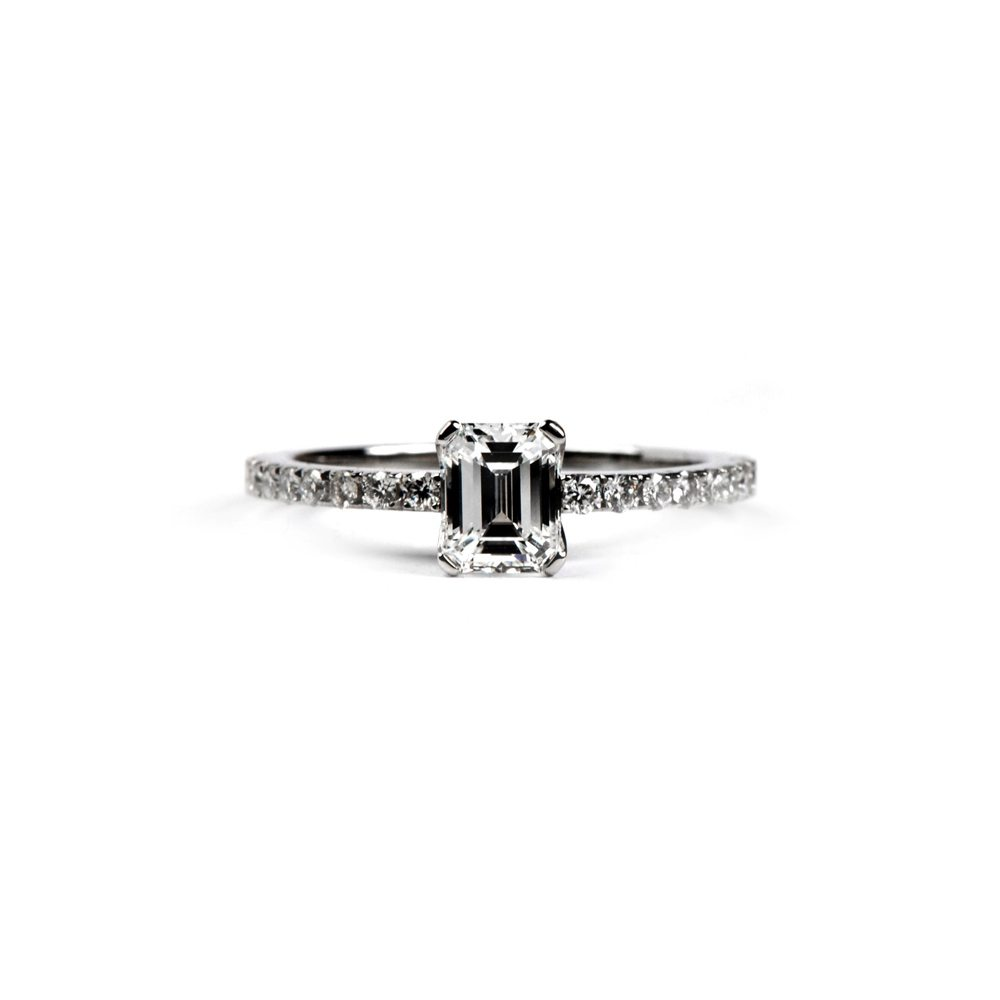 Emerald cut diamond castel ring