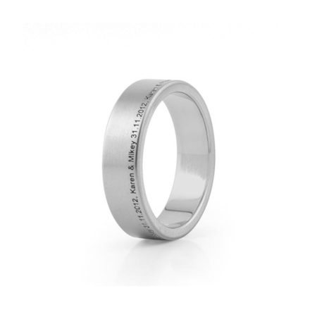 Titanium ring with offset engraving