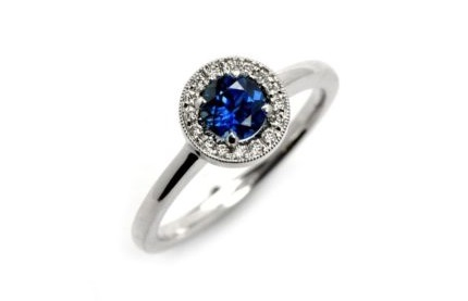 white gold vintage sapphire halo engagement ring