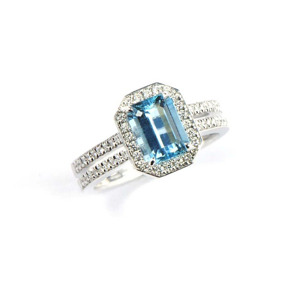 White Gold Ring with rectangular pale blue centre stone and double diamond band