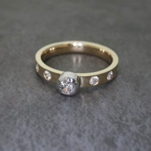 Bezel set ring with flush set diamonds
