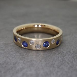 Diamond and Sapphire Scattered Ring