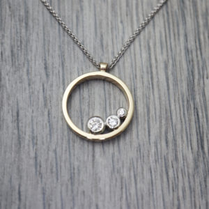Three Stone Round Pendant