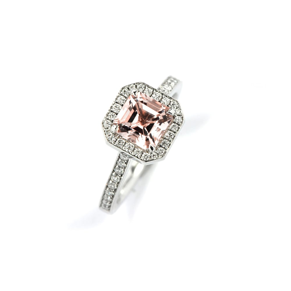 Art Deco style ring with ascher cut morganite centre stone and diamond surround in white gold with diamonds set in band