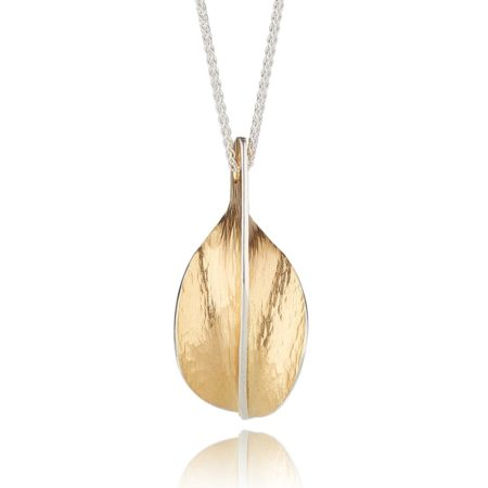 GOLD AND SILVER PENDANT ON LONG CHAIN