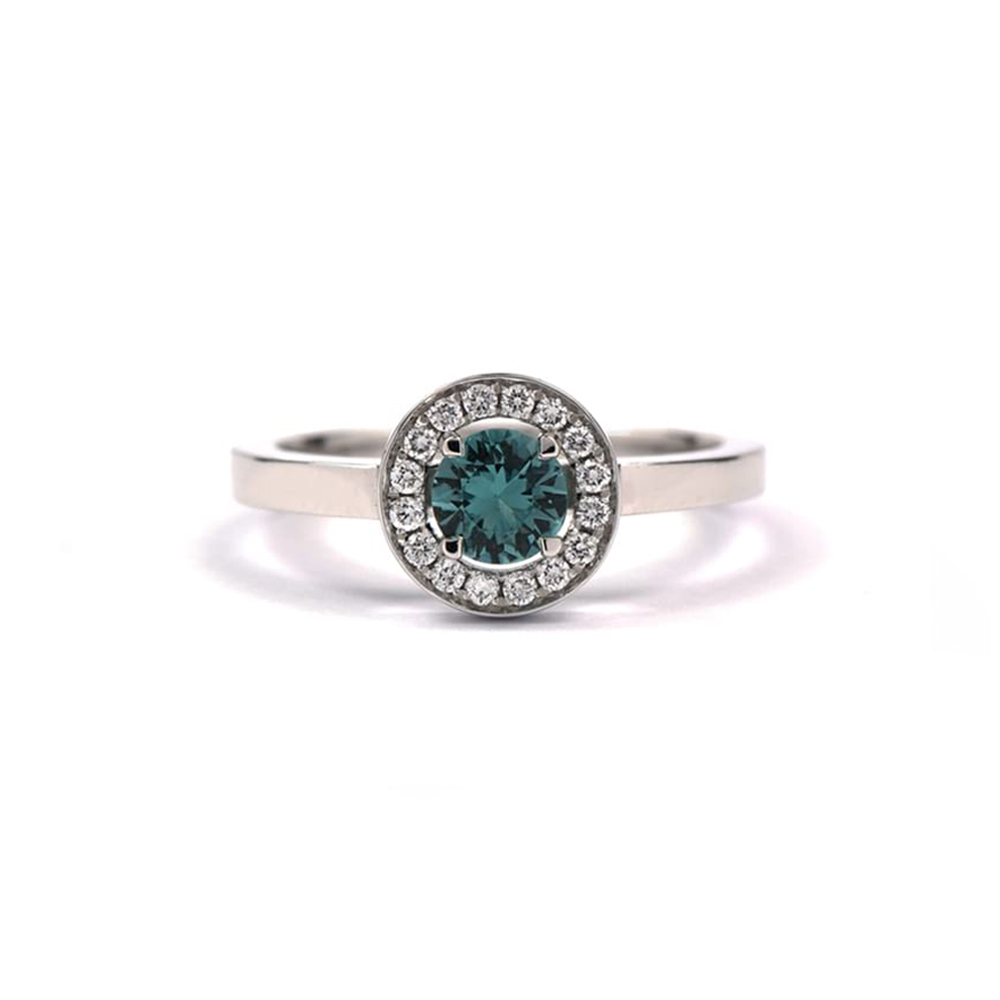 White gold ring set with turquoise stone and diamond surround