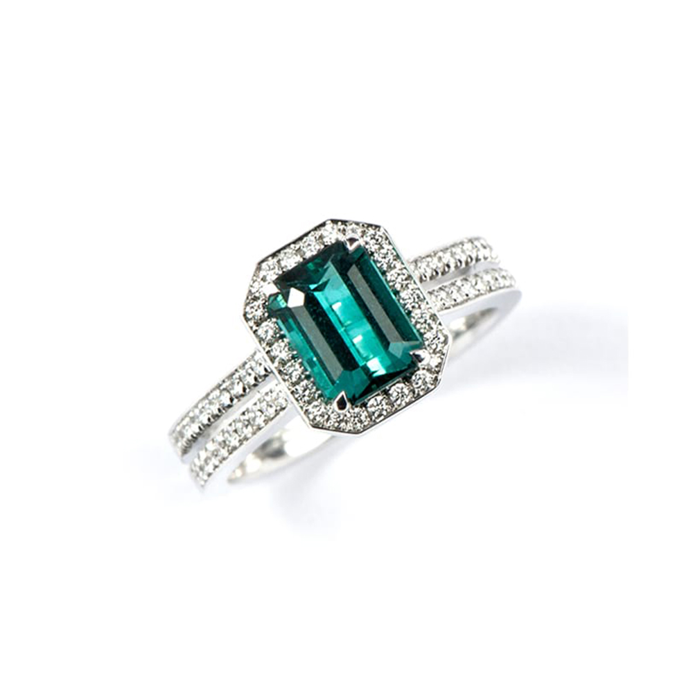 White gold diamond ring with turquoise centre stone and diamond surround