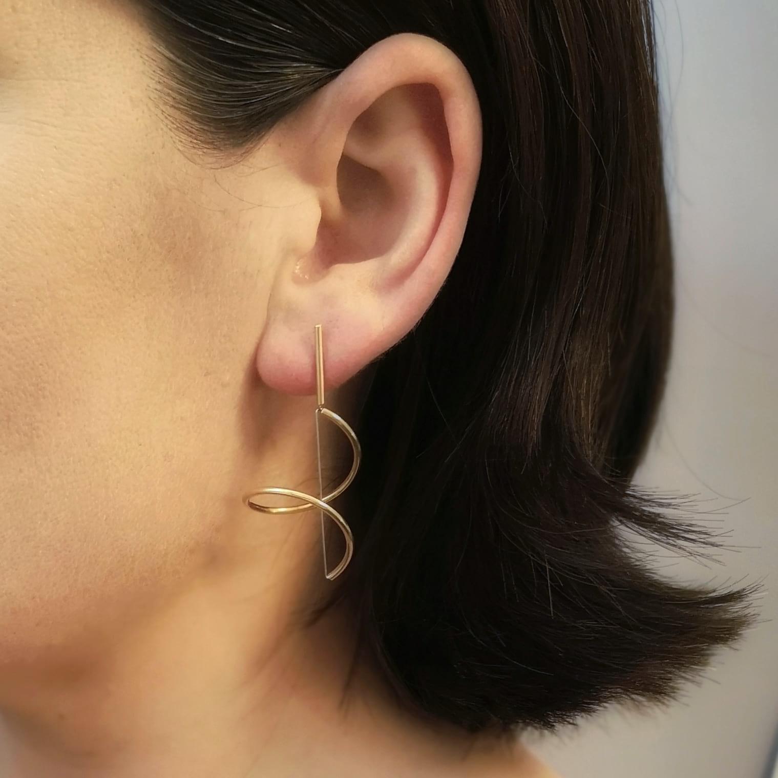 Gold Swirl Earrings on Model