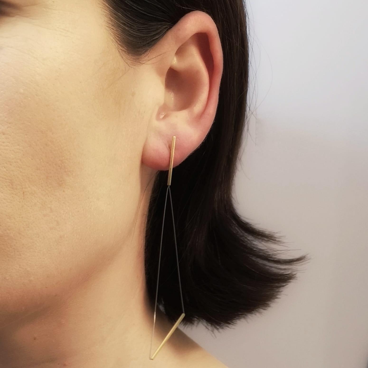 Gold Triangular Drop Earrings on Model